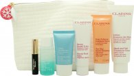 Clarins Relaxing Weekend Partners Gift Set 50ml Beauty Flash Balm + 100ml Hand and Nail Cream + 50ml One-Step Gentle Exfoliating Cleanser + 15ml Hydra Quench Cream + 30ml Instant Eye Makeup Remover + 3ml Wonder Perfect Mascara + Bag